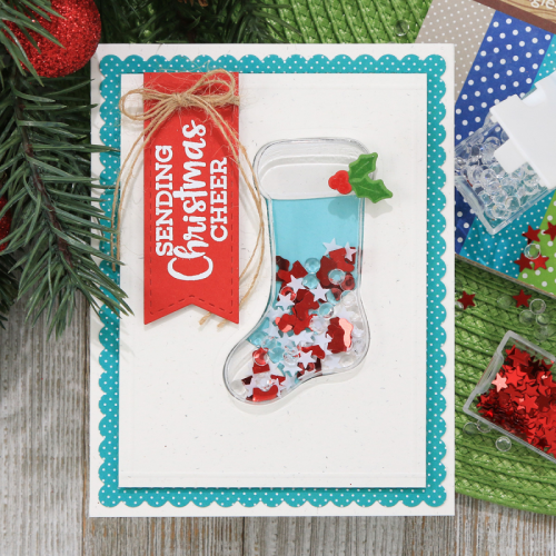 Shape shaker card using the Jillibean Soup shaker card stocking and insert, stamp and die set, shaker fillers, and all about dots 6 x 8 paper pad.  How to create a shaker card.  Jillibean Soup cardmaking.  #jillibeansoup #cardmaking #shakercard #stocking #allaboutdots #paperpad