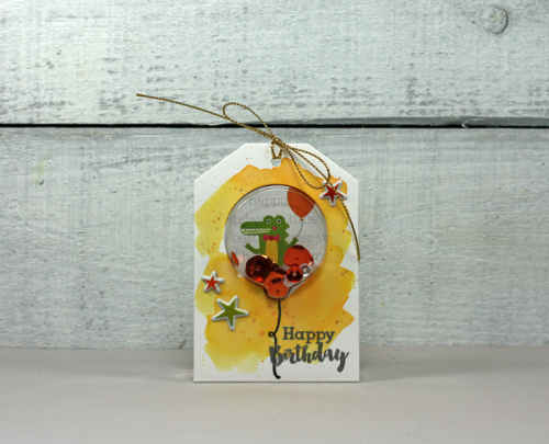 Shape shaker tag using Souper Celebration, stamp and die sets, and puffy stickers.  How to make a shape shaker tag.  Jillibean Soup cardmaking.  #jillibeansoup #cardmaker #shapeshaker #tag #soupercelebration