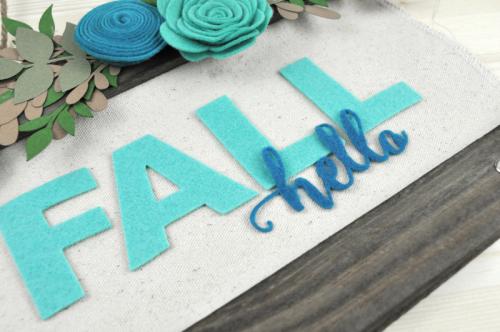 Fall Canvas Sign video tutorial by Jen Gallacher for Jillibean Soup. Autumn Sign YouTube video with Jillibean Soup's Hanging Canvas sign and felt flowers. #autumnsign #fallcraft #jillibeansoup