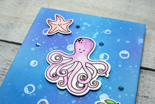 Octopus Clear Stamp & Die Set Card with shaker jewels and sequins.  Jillibean Soup cardmaking.  How to stamp on a card.  #stamping #jillibeansoup #clearstampandieset #octopus #shakerfillers
