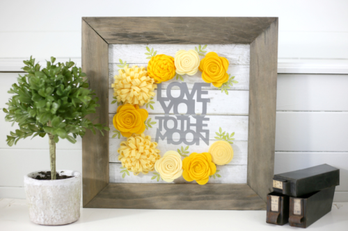 Shiplap surface home decor using Jillibean Soup Mix the Media, felt flowers, 2 Cool For School and cut files.  How to create home decor with felt flowers.  Jillibean Soup home decor.  #jillibeansoup #mixthemedia #homedecor #diy #surfaces #feltflowers
