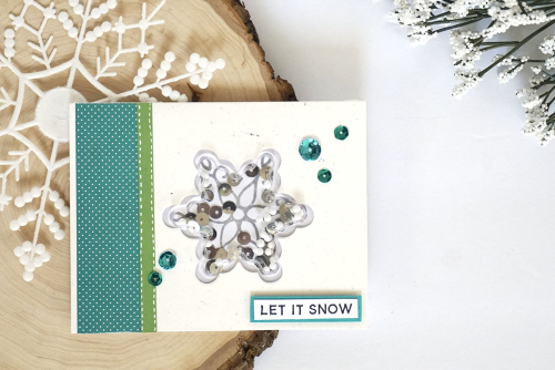 Shape shaker card using Jillibean Soup's All About Dots paper pad, snowflake shape shaker card and insert, snow mix shaker fillers, sequins, stamp and die set.  How to make a shape shaker card.  Jillibean Soup cardmaking.  #jillibeansoup #cardmaking #shapeshaker #allaboutdots #snowflake #stampanddieset