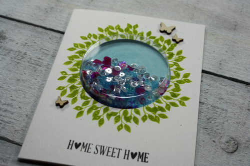 Shape shaker card using a large circle shape shaker, wood veneer, shaker jewels & sequins, and seed beads.  How to make a shaker card.  Jillibean Soup cardmaking.  #jillibeansoup #cardmaking #clearstamps #woodveneer