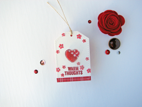 Shape shaker tag using Jillibean Soup's small heart shaker tag, All About Plaid paper pad, shaker fillers, stamp and die set, and stamps.  How to create a shape shaker tag.  Jillibean Soup cardmaking.  #jillibeansoup #cardmaking #tag #heart #shapeshaker #allaboutplaidpaperpad