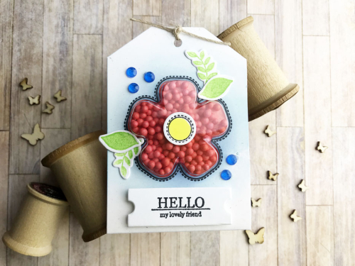 Shape shaker tag using Jillibean Soup's shape shaker flower tag and insert, flower bloom stamp and die set and shaker filler foam balls.  How to make a shaker tag.  Jillibean Soup cardmaking.  #jillibeansoup #cardmaking #tag #flower #flowerbloomstampanddieset