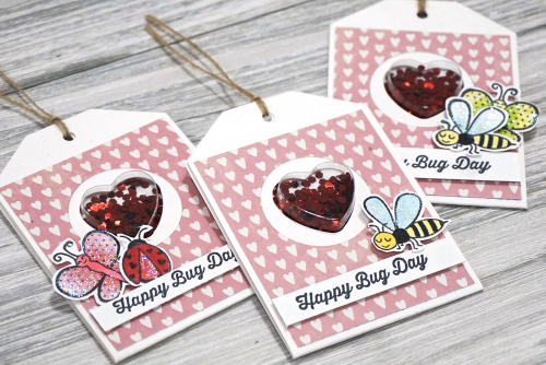 Shape shaker tag using Jilllibean Soup's small heart shaker tag and insert and love bug stamps.  How to make a shaker tag.  Jillibean Soup cardmaking. #jillibeansoup #cardmaking #shakertag #smallheart #stamping #lovebug