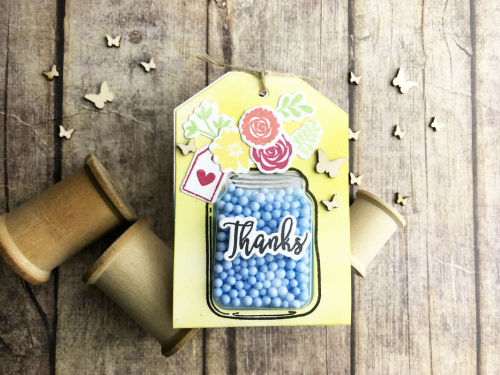 Shape shaker tag using Jillibean Soup's jar shaker tag and insert, jar goodness stamp and die set , and shaker filler foam balls.  How to make a shaker tag.  Jillibean Soup cardmaking.  #jillibeansoup #cardmaking #shakertag #jar #jargoodnessstampanddieset