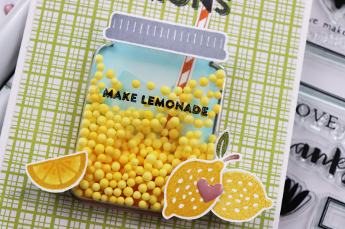 Shape shaker card using Jillibean Soups Spoonful of Soul patterned paper, Spoonful of Soul clear stamps, Lemonade clear stamps, Spoonful of Soul epoxy stickers, Jar shaker card and insert, and shaker fillers.  How to stamp on a shaker card.  Jillibean Soup cardmaking.  #jillibeansoup #cardmaking #shapeshaker #spoonfulofsoul #jar #lemonade #stamping