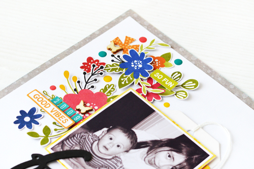 Scrapbook layout using Jillibean Soup's Fur Fusion mini alphas, tags, and wood veneer butterflies, and the Rainbow Roux collection including patterned paper, pea pod parts, epoxy stickers, foam stickers, coordinating stickers, washi sheets, and clear stamps.  How to fussy cut elements from pattern paper for layouts.  Jillibean Soup scrapbooker.  #jillibeansoup #scrapbooker #scrapbooklayout #rainbowroux #fussycut #patternpaper