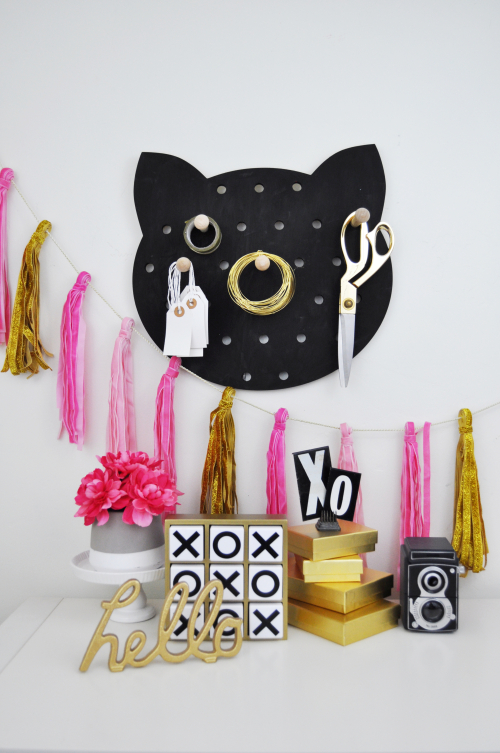 Spray painted cat shaped pegboard by Jillibean Soup and Hampton Art  for JoAnn stores.