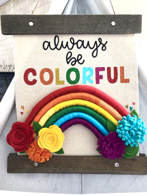 Home decor mix the media project using Jillibean Soup's hanging canvas, felt flowers, and Rainbow Roux epoxy stickers.  How to create a home decor project.  Jillibean Soup Mix the Media.  #jillibeansoup #homedecor #mixthemedia #hangingcanvas #feltlflower #rainbowroux