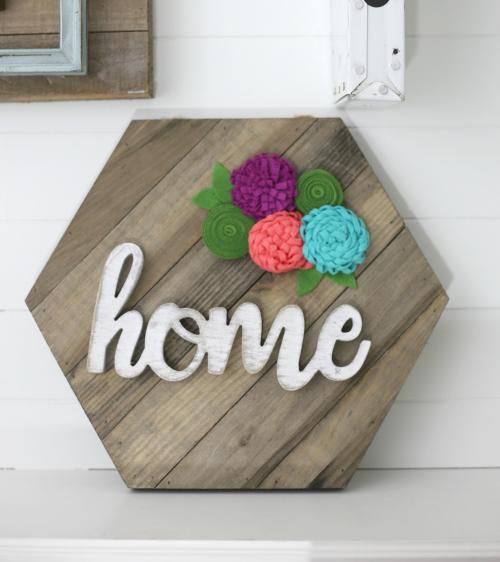Home Hexagon Wooden sign with felt flowers from Jillibean Soup. #jillibeansoup #mixthemedia #feltflowers #woodensign #woodenword