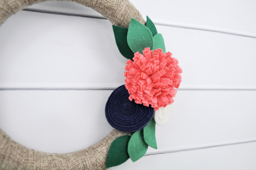 Ribbon wrapped wreath with felt flowers video tutorial by Jen Gallacher for Jillibean Soup. #wreath #feltflowers #DIYwreath #youtubevideo