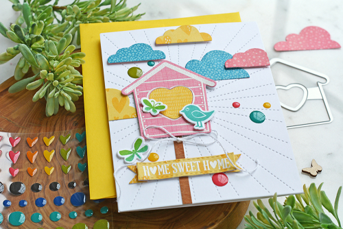 Stamped card created using Jillibean Soup's heart birdhouse stamp and die set and Rainbow Roux patterned paper and epoxy stickers.  How to stamp on a card.   Jillibean Soup cardmaking.  #jillibeansoup #cardmaking #rainbowroux #heartbirdhouse #stamping #stampanddieset