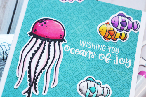 Stamped card using Jillibean Soup's Hardy Hodgepodge patterned paper and stamp and die sets including Octopus, Whale Done and Hug in a Mug.  Coloring stamped images on a card.  Jillibean Soup cardmaking.  #jillibeansoup #cardmaking #cards #stamp #stampanddieset #octopus #whaledone #huginamug #coloring