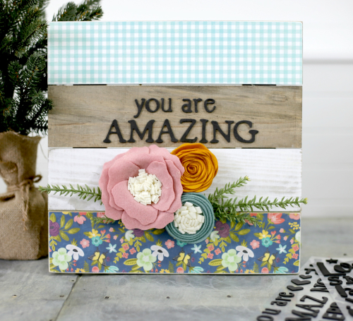 You Are Amazing Plank Farmhouse Sign using scrapbooking paper and felt flowers. #feltflowers #modpodge #farmhousesign #planksign #jillibeansoup #mixthemedia